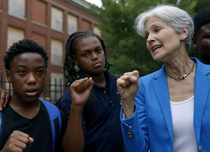Green Party presidential candidate Jill Stein, right, poses with students at South Austin neighborhood Thursday, Sept. 8, 2016, in Chicago. (AP Photo/Tae-Gyun Kim)