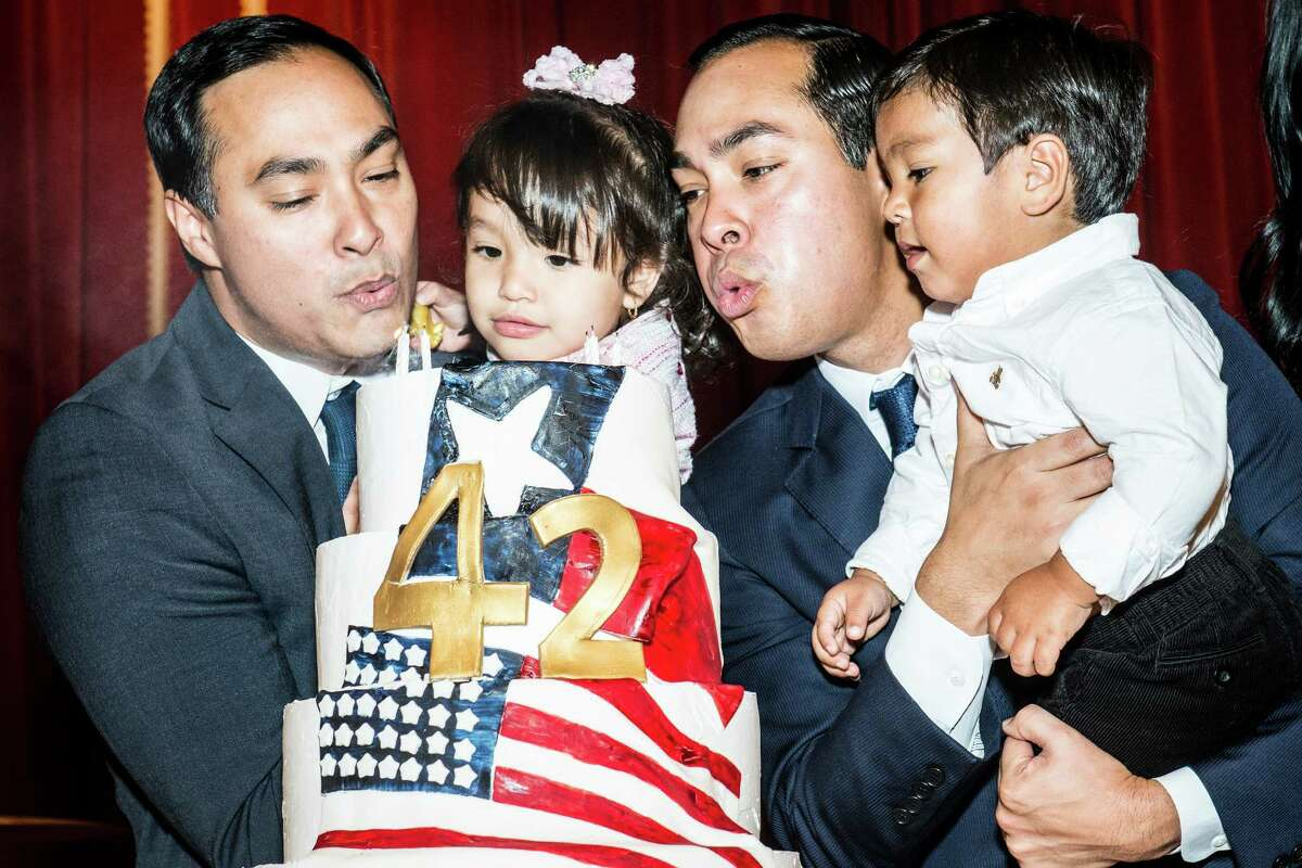 Brothers Joaquin, left, and Julian Castro, right blow out their birthday cake while holding their children, Andrea Elena Castro and Cristián Julián Castro, respectively during their birthday party on Friday, September 16, 2016 in San Antonio, Texas. Joaquin Castro is a Democratic U.S. Representative for Texas' 20th district and Julián Castro is the U.S. Secretary for Housing and Urban Development. The twin brothers celebrated their 42nd birthday.