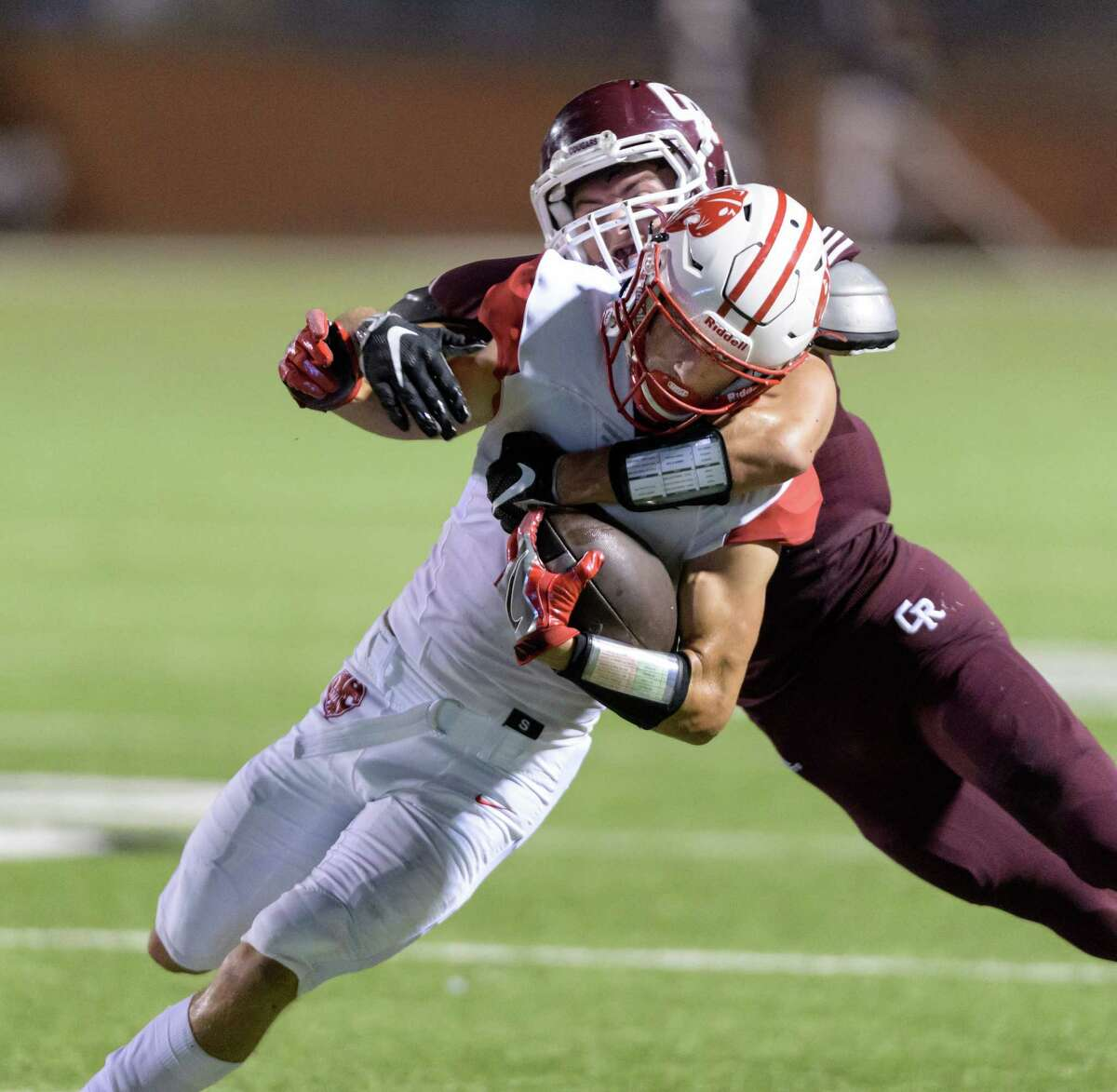 Jaxon Borowski (2) of the Katy Tigers is brought down in the first half after a short reception by Devon Wygal (23) of the Cinco Ranch Cougars in a high school football game on Friday, September 16, 2016 at Rhodes Stadium in Katy Texas.