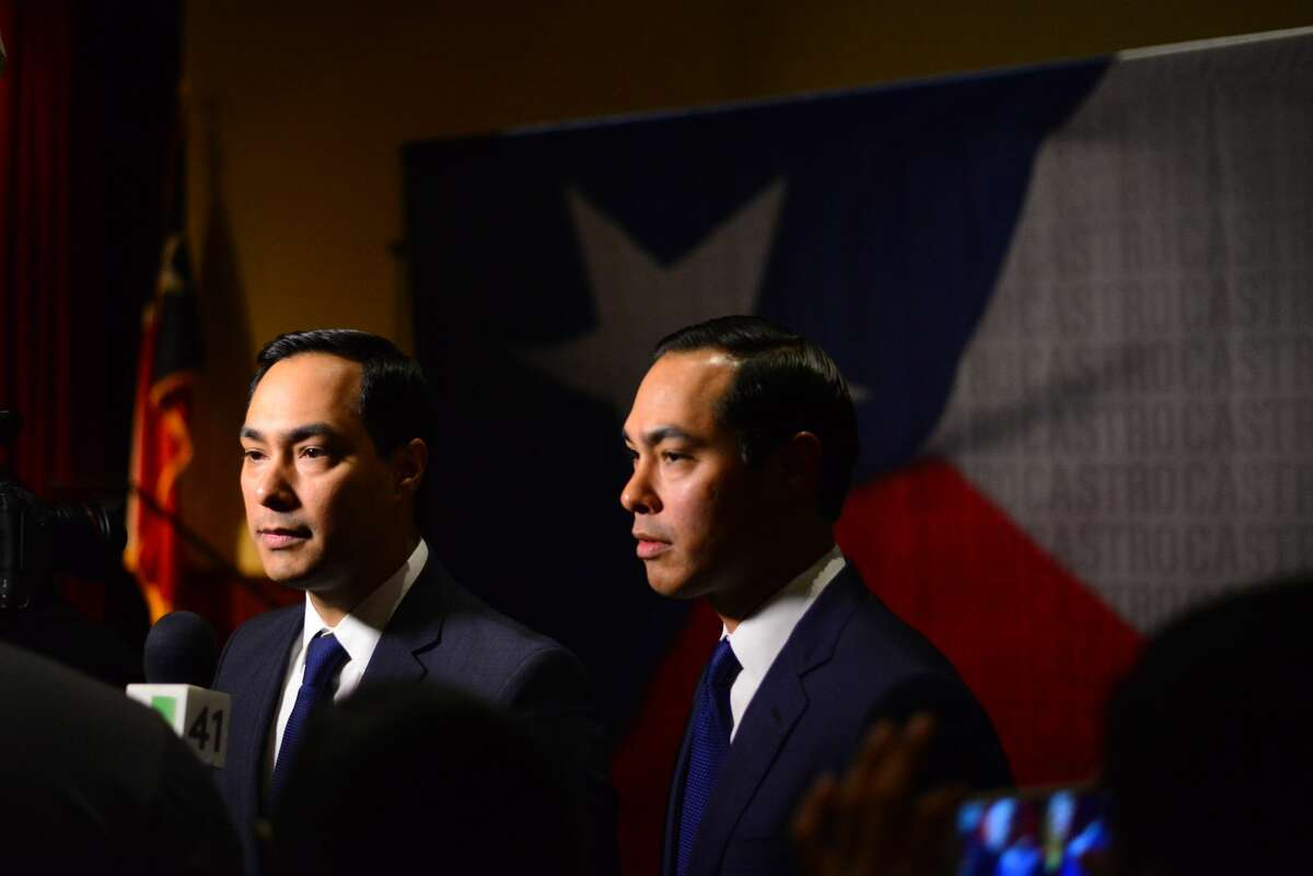 FILE PHOTO - Joaquin and Julián Castro talk to attendees at their 42nd birthday party on Friday, Sept. 16, 2016, at The Pearl Stable.