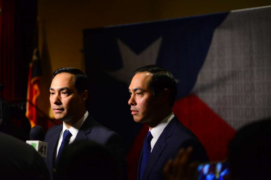 FILE PHOTO — Joaquin and Julián Castro talk to attendees at their 42nd birthday party on Friday, Sept. 16, 2016, at The Pearl Stable. Photo: Kody Melton