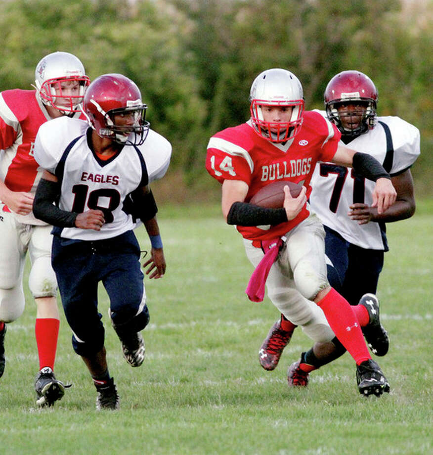 Paul P. Adams/Huron Daily Tribune   Owen-Gage running back Jake Warack gains yardage in the first quarter against Burton Madison, Friday, in Owendale.