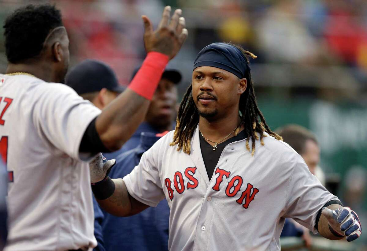 Boston Red Sox's Hanley Ramirez, right, celebrates with David Ortiz, left, after hitting a home run against the Oakland Athletics in the third inning of a baseball game Saturday, Sept. 3, 2016, in Oakland, Calif. (AP Photo/Ben Margot) ORG XMIT: OAS113