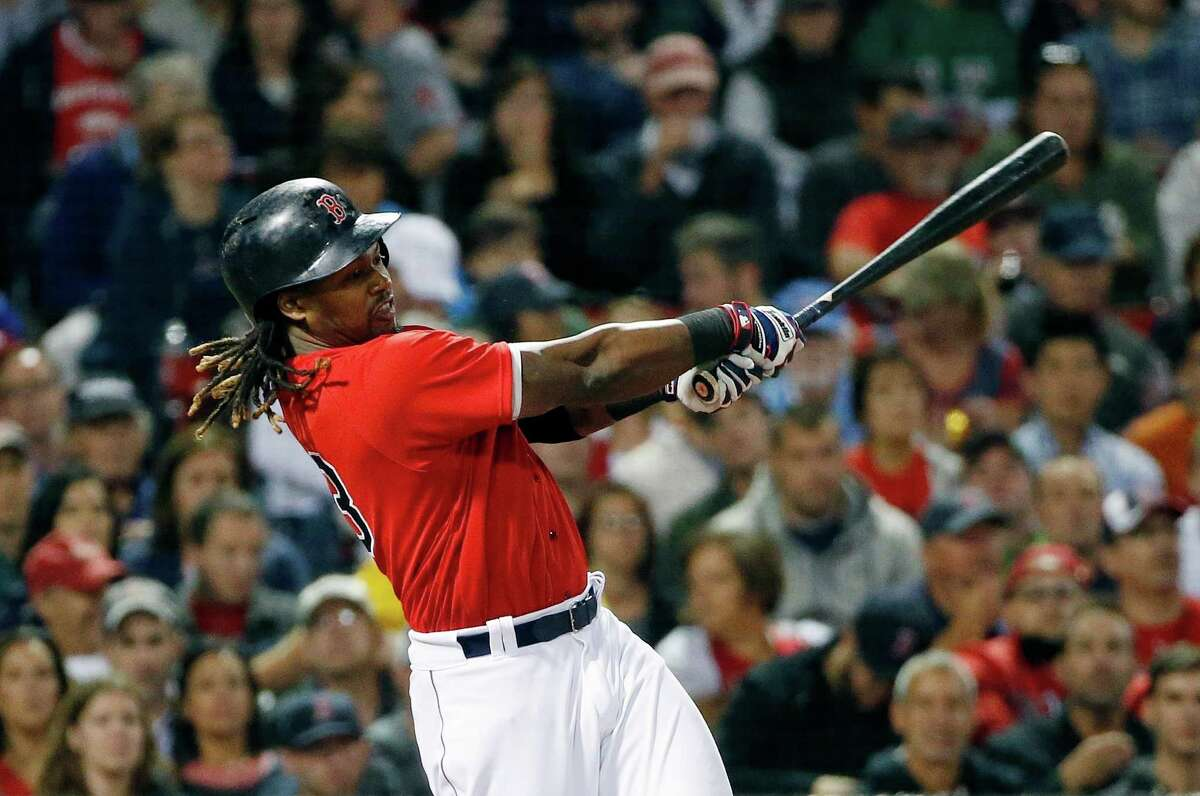 Boston Red Sox's Hanley Ramirez follows through on his solo home run during the fourth inning of a baseball game against the New York Yankees in Boston, Friday, Sept. 16, 2016. (AP Photo/Michael Dwyer) ORG XMIT: MAMD108