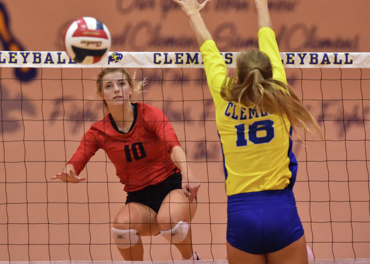 New Braunfels Canyon's Skyler Clark (left) watches a shot go past Clemens Lauren Teske during their match Friday night.
