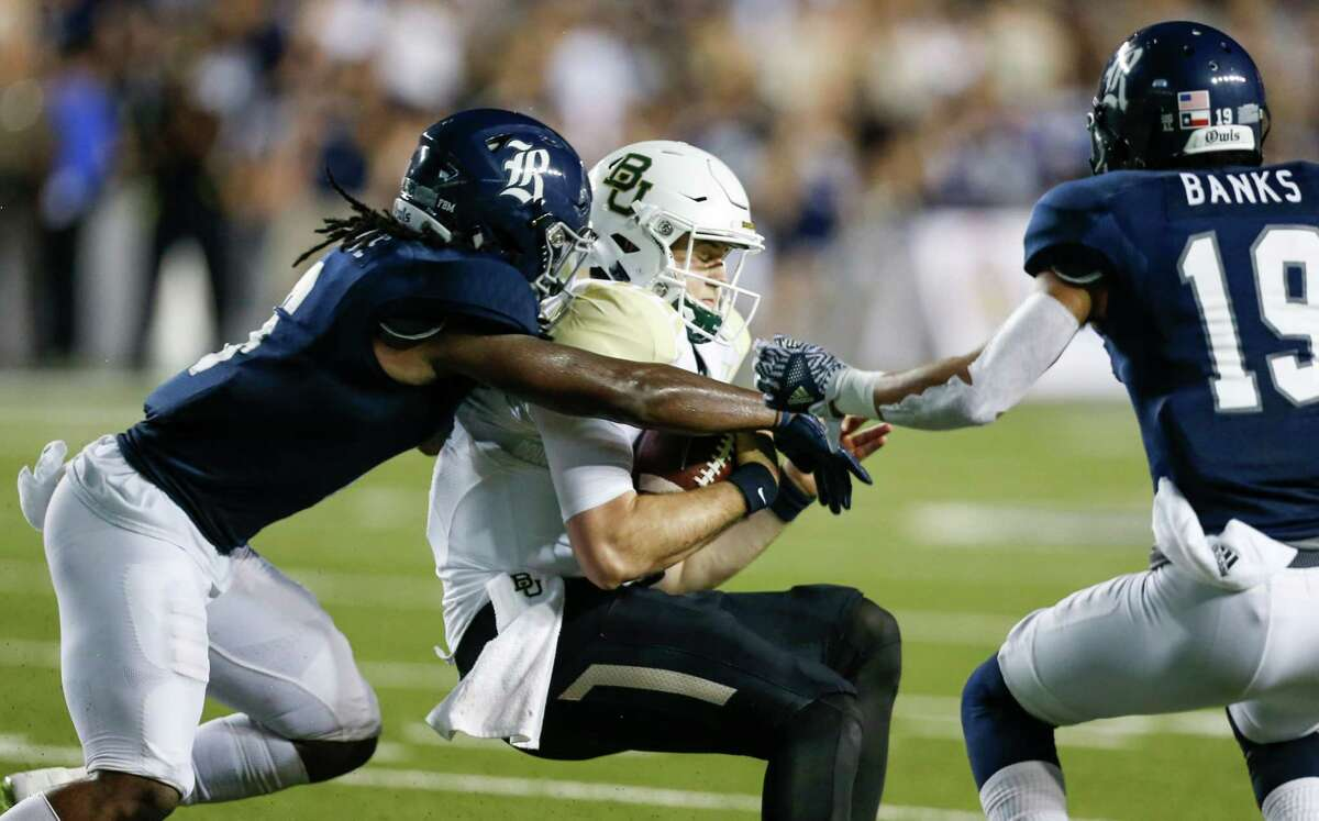 Rice safety Destri White (6) and cornerback V.J. Banks (19) stop Baylor quarterback Seth Russell (17) after a short gain during the second quarter of an NCAA football game at Rice Stadium on Friday, Sept. 16, 2016, in Houston.