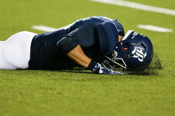 Rice quarterback Nate German (13) reacts after kicking a short punt out of bound against Baylor during the second quarter of an NCAA football game at Rice Stadium on Friday, Sept. 16, 2016, in Houston.