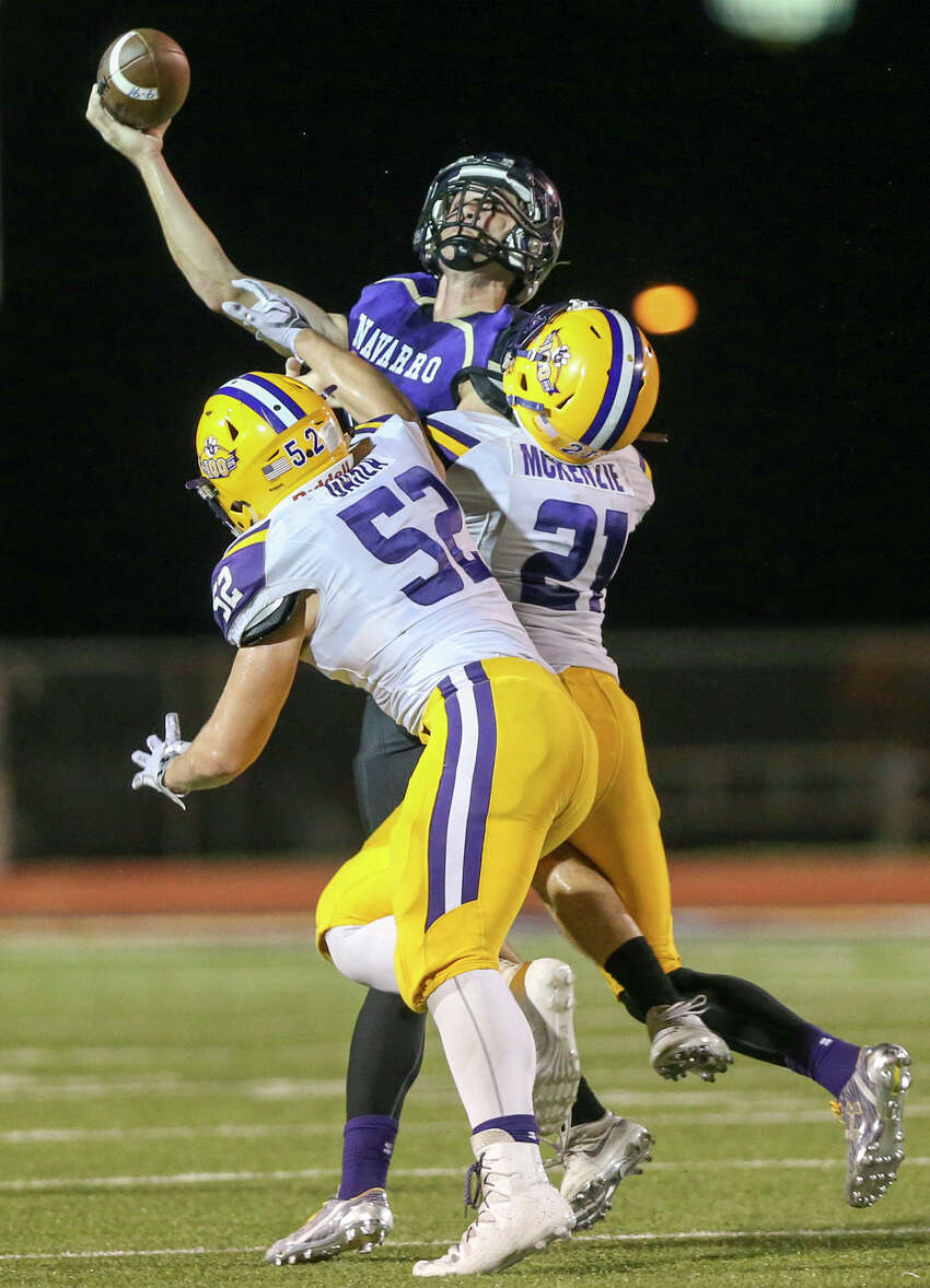 Navarro quarterback Will Eveld tries to pass the ball under pressure from La Grange's Dameon McKenzie (right) and John Garza during the first half of their non-district game at Erwin-Lee Field in Geronimo on Friday, Sept. 16, 2016. MARVIN PFEIFFER/ mpfeiffer@express-news.net