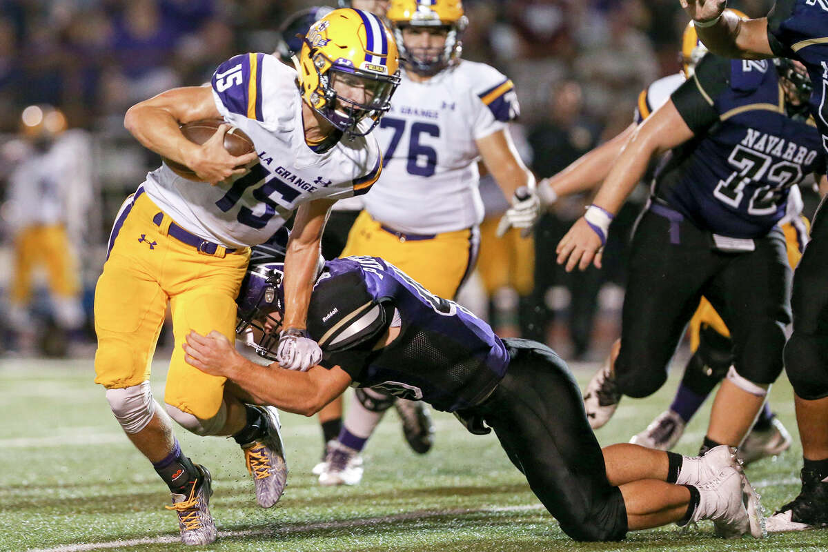 Navarro's Ronnie Goldman brings down La Grange quarterback Colter Siptak during the second half of their non-district game at Erwin-Lee Field in Geronimo on Friday, Sept. 16, 2016. Navarro beat La Grange 42-13. MARVIN PFEIFFER/ mpfeiffer@express-news.net