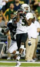 Baylor wide receiver KD Cannon (9) beats Rice cornerback J.T. Blasingame (14) for a deep reception during the second quarter of an NCAA football game at Rice Stadium on Friday, Sept. 16, 2016, in Houston. ( Brett Coomer / Houston Chronicle )