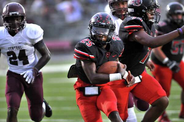 Memorial's Elijah Hines turns upfield on the way to a first quarter touchdown as the Titans hosted the Central Jaguars on Friday at Memorial Stadium in Port Arthur. (Mike Tobias/The Enterprise)