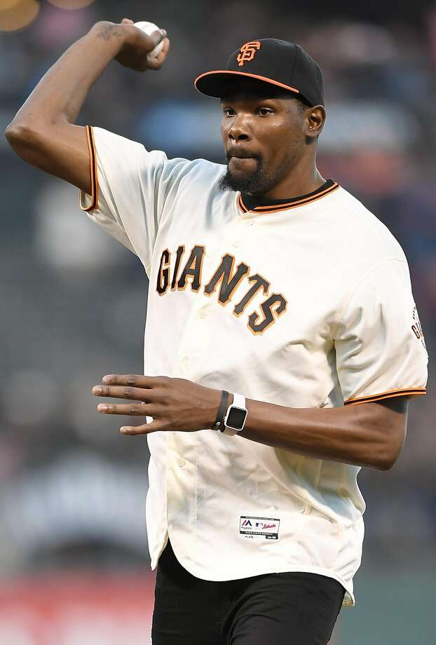 NBA player Kevin Durant of the Golden State Warriors throws out the ceremonial first pitch prior to the start of the game between the St. Louis Cardinals and San Francisco Giants at AT&T Park on September 16, 2016 in San Francisco. Photo: Thearon W. Henderson, Getty Images