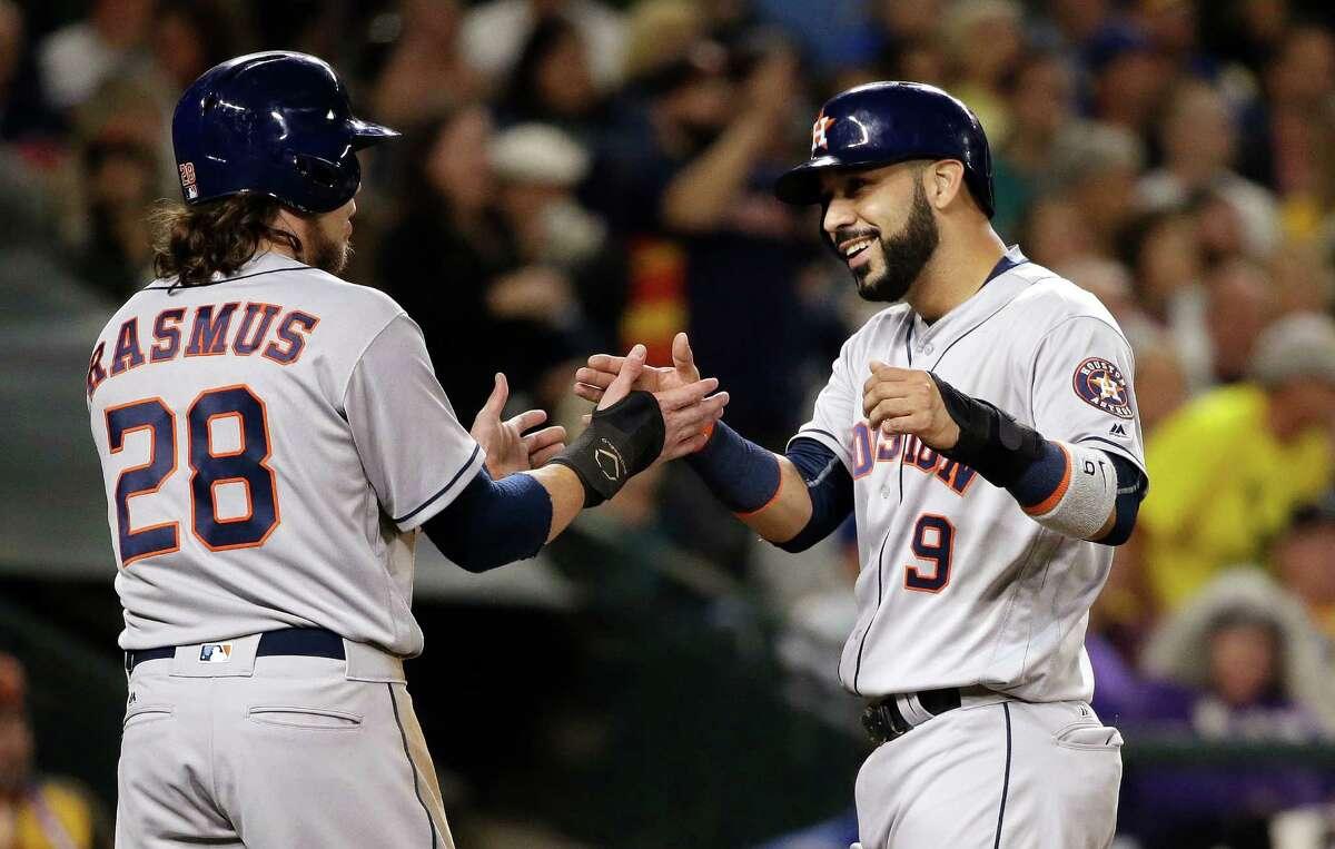 Houston Astros' Colby Rasmus (28) greets Marwin Gonzalez at home after both scored against the Seattle Mariners during the second inning of a baseball game Friday, Sept. 16, 2016, in Seattle. (AP Photo/Elaine Thompson)