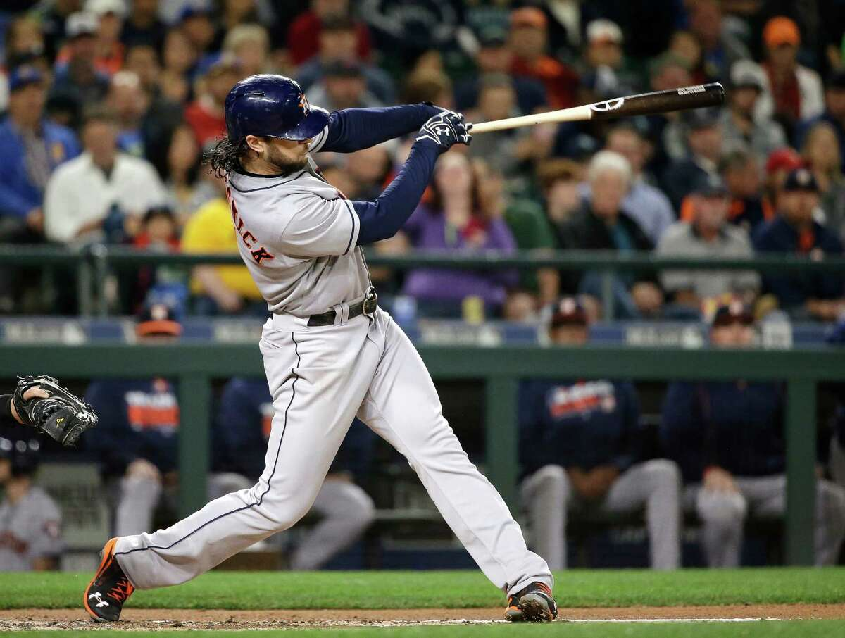 Houston Astros' Jake Marisnick doubles in a pair of runs against the Seattle Mariners during the second inning of a baseball game Friday, Sept. 16, 2016, in Seattle. (AP Photo/Elaine Thompson)