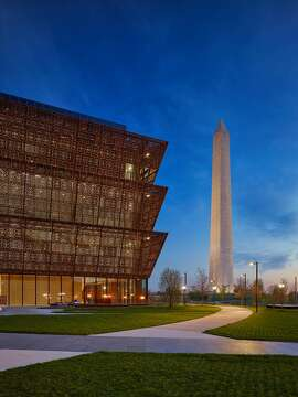 The Smithsonian's new National Museum of African American History and Culture, designed by David Adjaye, at dusk. Adjaye and his firm worked with Freelon Group and Davis Brody Bond.  Source: Alan Karchmer/Adjaye Associates
