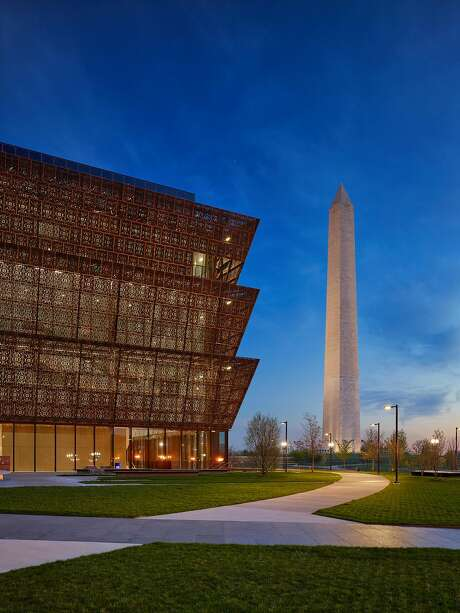The Smithsonian's new National Museum of African American History and Culture, designed by David Adjaye, at dusk. Adjaye and his firm worked with Freelon Group and Davis Brody Bond.  Source: Alan Karchmer/Adjaye Associates Photo: Alan Karchmer, Photography By Alan Karchmer For