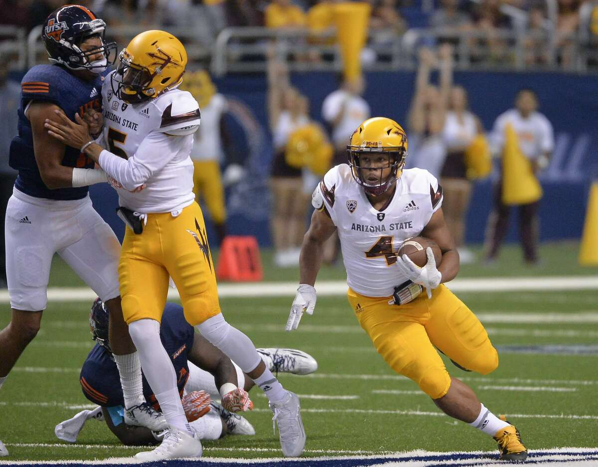 Arizona State running back Demario Richard (4) carries during the first half of an NCAA college football game against UTSA, Friday, Sept. 16, 2016, in San Antonio. (AP Photo/Darren Abate)