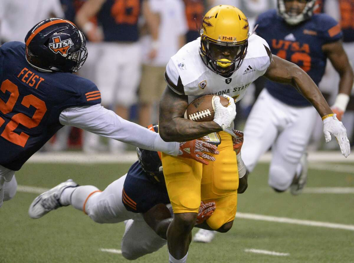 Arizona State wide receiver Kalen Ballage carries against UTSA linebacker Ronnie Feist and another defender, rear, during the first half of an NCAA college football game, Friday, Sept. 16, 2016, in San Antonio. (AP Photo/Darren Abate)