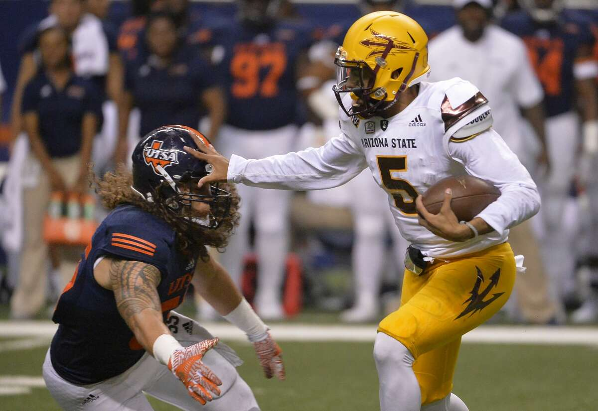 Arizona State quarterback Manny Wilkins (5) pushes off against UTSA linebacker Josiah Tauaefa during the first half of an NCAA college football game, Friday, Sept. 16, 2016, in San Antonio. (AP Photo/Darren Abate)