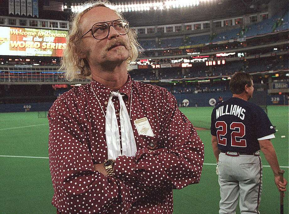 "File-This Oct. 23, 1992, file photo shows Canadian author W.P. Kinsella standing on the baseball field before game five of the World Series between Toronto Blue Jays and Atlanta Braves  in Toronto, Ontario. Kinsella, the author of ""Shoeless Joe,"" the award-winning novel that became the film ""Field of Dreams,"" has died at 81. His literary agency confirms the writer had a doctor-assisted death on Friday, Sept. 16, 2016, in Hope, British Columbia, Canada. The agency did not provide details about Kinsella's health. (AP Photo/Rusty Kennedy,File) Photo: RUSTY KENNEDY, Associated Press"