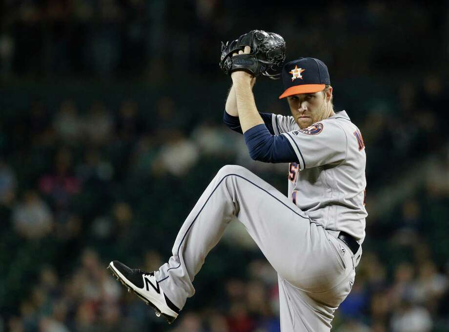 Houston Astros starting pitcher Collin McHugh throws against the Seattle Mariners in a baseball game Friday, Sept. 16, 2016, in Seattle. (AP Photo/Elaine Thompson) Photo: Elaine Thompson, Associated Press / AP