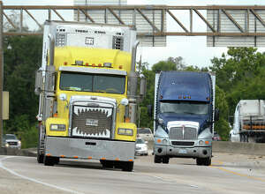 The federal government is considering a law that could limit 18 wheeler speeds by installing governors on the engine. Many truck drivers say the law will create more road hazards on the roads. Tractor trailers travel through Beaumont on Interstate 10 Friday. Photo taken Friday, September 15, 2016 Guiseppe Barranco/The Enterprise