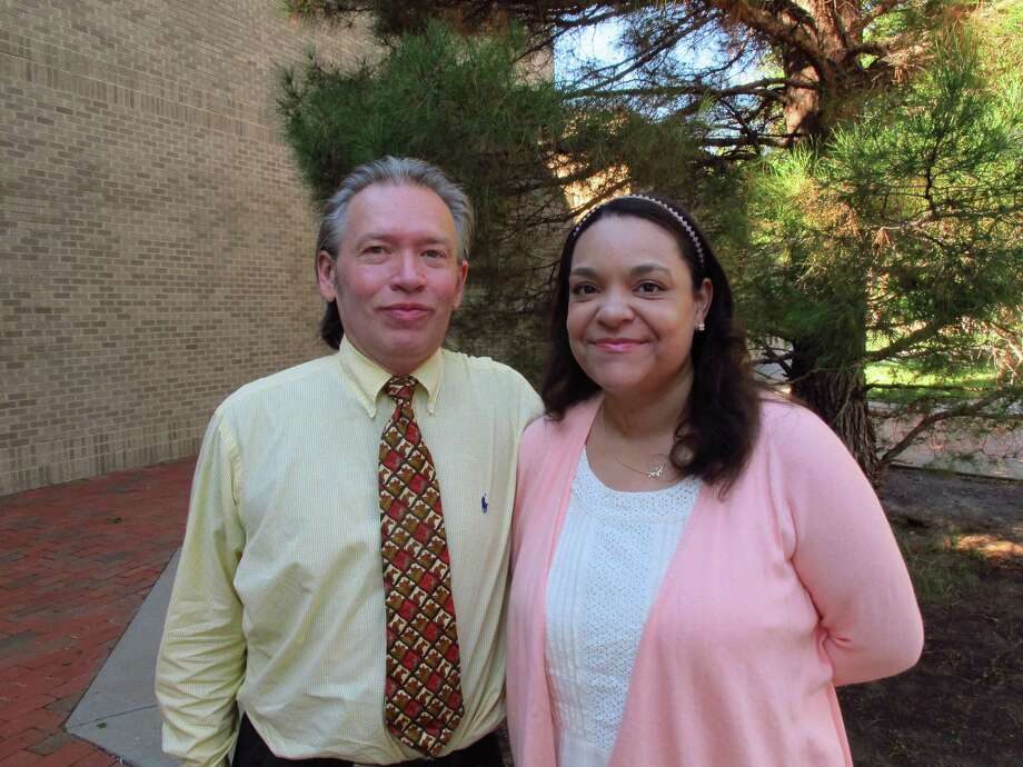 In a photo taken Sept. 9, 2016, William A. and Claire Rembis stand outside the Texas Tech University Law School in Lubbock, Texas. The couple is trying to regain custody of their 11 children after Texas child welfare officials took custody of them following allegations that include some of the children going into garbage bins to get scraps of food to eat. Photo: Betsy Blaney, AP / Copyright 2016 The Associated Press. All rights reserved.