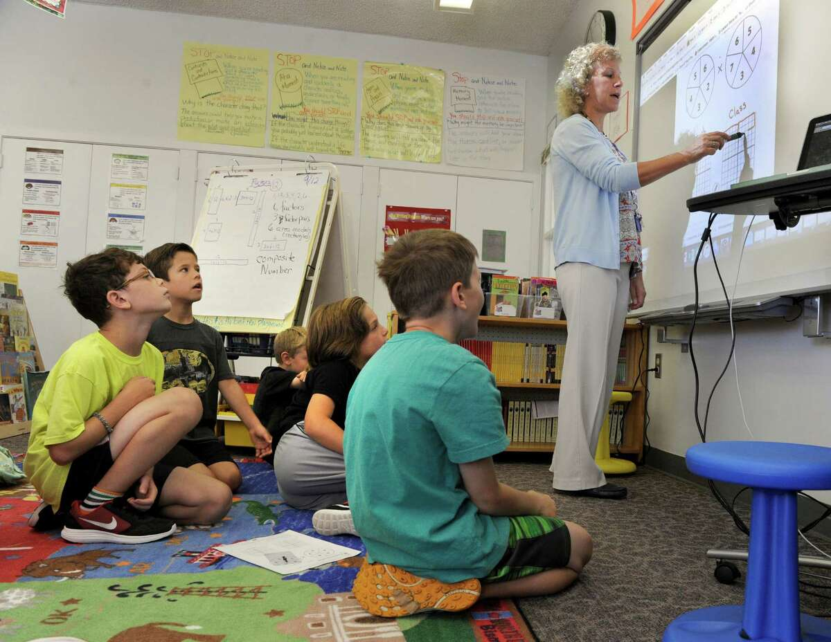 Fourth-grade teacher Pam Lucchesi leads the class in a math exercise at Booth Free School in Roxbury.