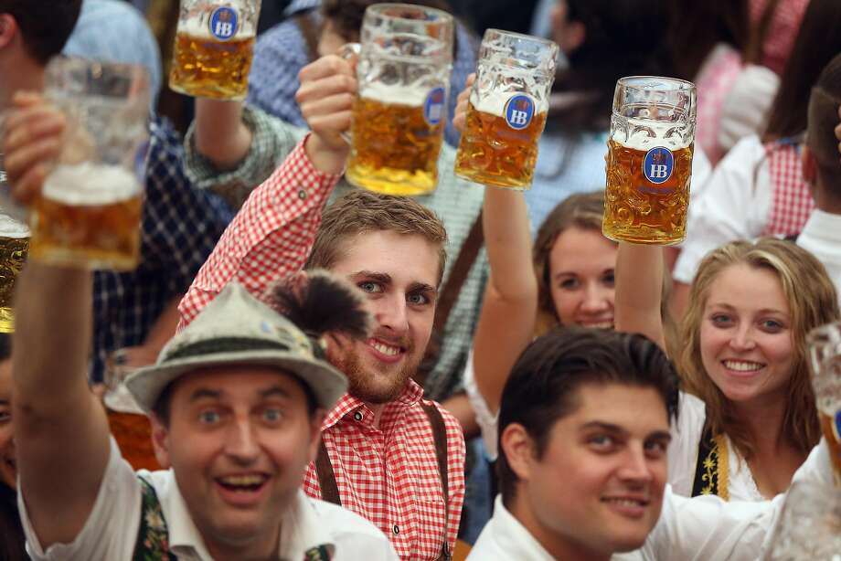 MUNICH, GERMANY - SEPTEMBER 17:  Visitors hold up one-litre glasses of beer to kick off the 2016 Oktoberfest beer festival in the Hofbraeu tent at Theresienwiese on September 17, 2016 in Munich, Germany. The 2016 Oktoberfest is taking place under heightened security due to fears over international terrorism. The fest will be open to the public through October 3.  (Photo by Johannes Simon/Getty Images) Photo: Johannes Simon, Getty Images