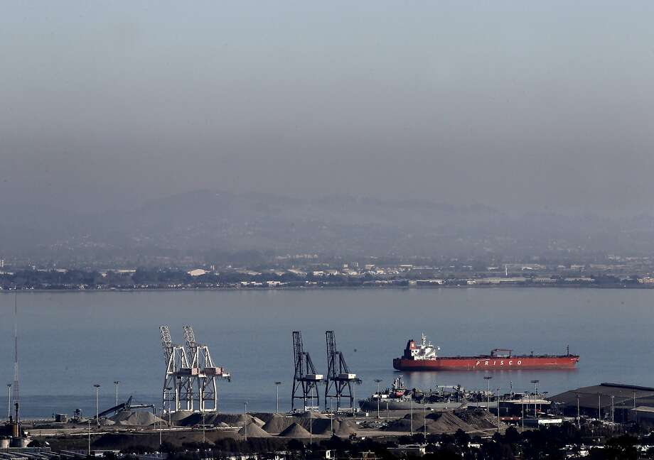 "The Bay Area Air Quality Management District issued a ""Spare the Air"" alert Saturday. A file photo shows smog hanging over the East Bay in 2011. Photo: Brant Ward, The Chronicle"