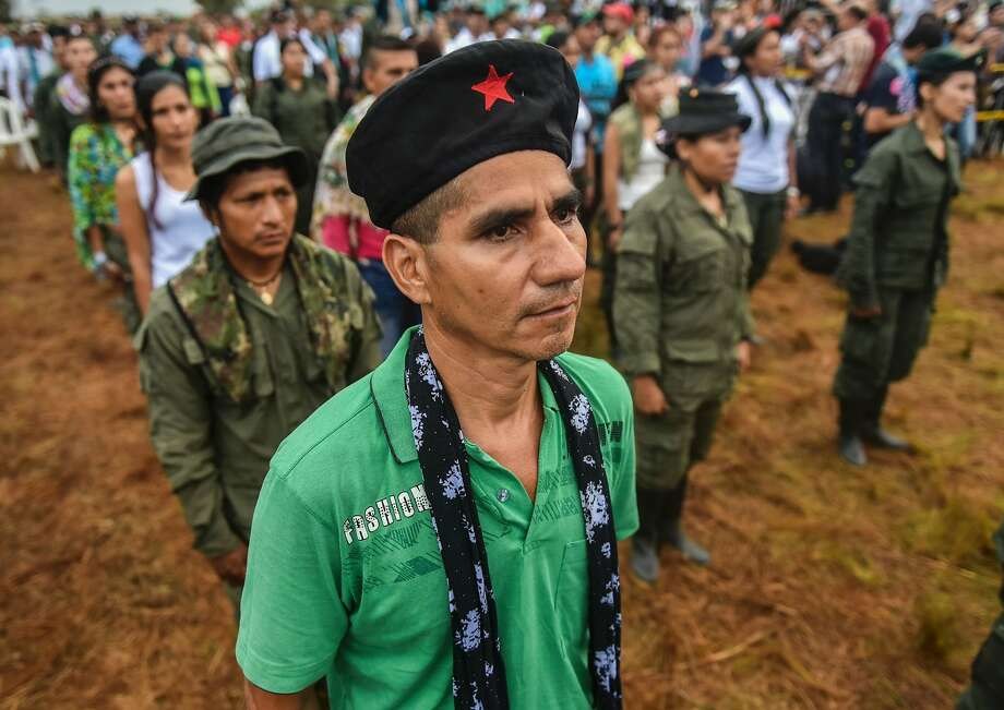 Members of the Revolutionary Armed Forces of Colombia attend the opening ceremony of their conference near San Vicente del Caguan, Colombia. Photo: LUIS ACOSTA, AFP/Getty Images