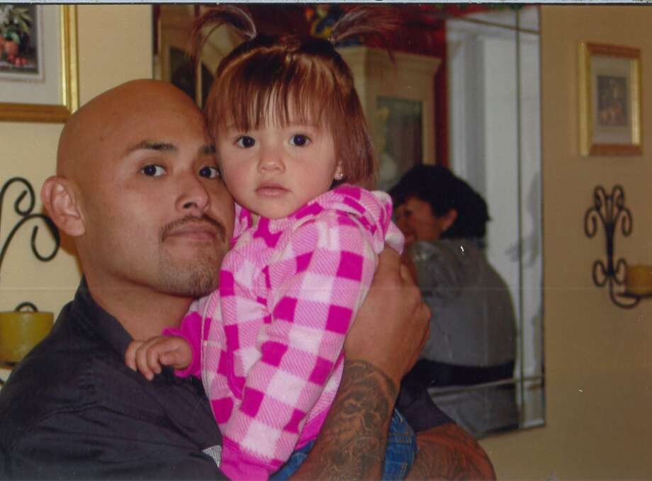 Benny Herrera, shown with daughter Abygail, was fatally shot by a Tustin officer in December 2011. Photo: Associated Press