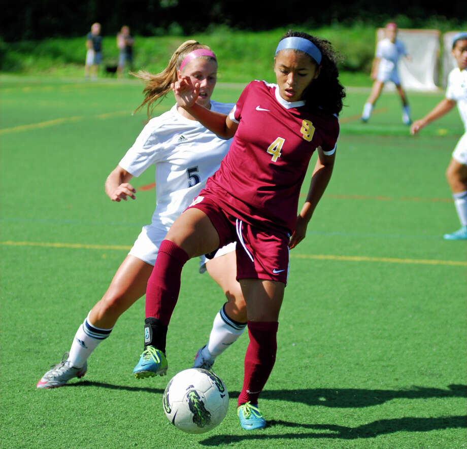 St. Joseph sophomore Jessica Mazo tries to control the ball while Wilton's Paige Gladstein defends during a game on Saturday. Photo: Ryan Lacey / Hearst Connecticut Media / Westport News Contributed
