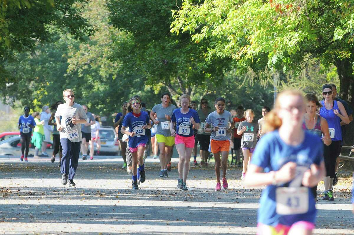 Runners make their way through Washington Park during the 2nd Annual Falcon 5K run/walk on Sunday, Sept. 28, 2014, in Albany, N.Y. The event is a fundraiser for the Albany Booster Club. (Paul Buckowski / Times Union)