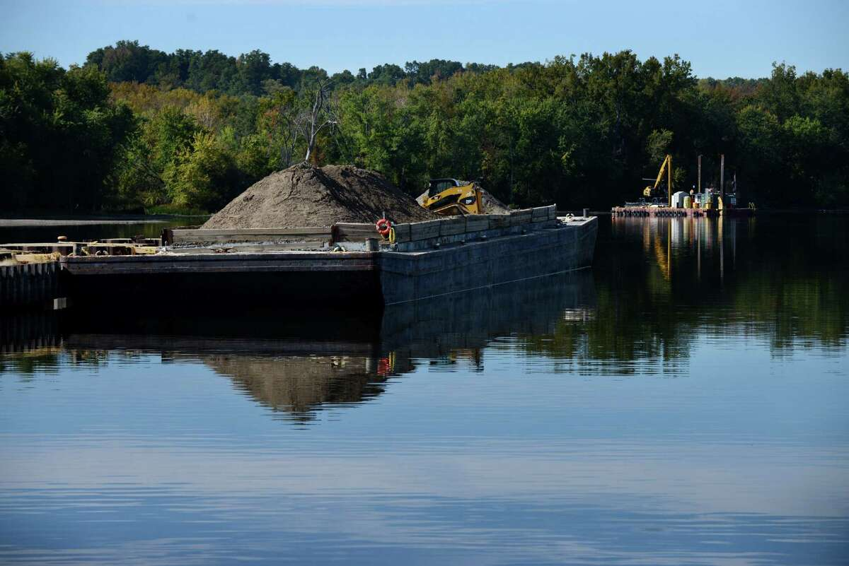 Equipment sits dormant at a PCB dredge site just north of Lock 2 on the Hudson River Monday afternoon, Oct. 5, 2015, in Halfmoon, N.Y. General Electric announced Monday that it has completed dredging in New York?'s upper Hudson River. (Will Waldron/Times Union)