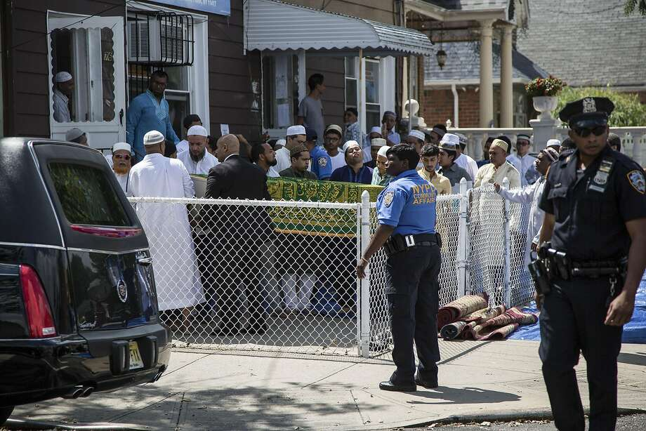 FILE -- People gather for the funeral of slain Imam Maulana Alauddin Akonjee at the Al-Furqan Jame Masjid mosque in  New York, Aug. 15, 2016. Hate crimes against American Muslims have soared to their highest levels since the aftermath of the Sept. 11, 2001 attacks, according to data compiled by researchers. (Christopher Lee/The New York Times) Photo: CHRISTOPHER LEE, NYT