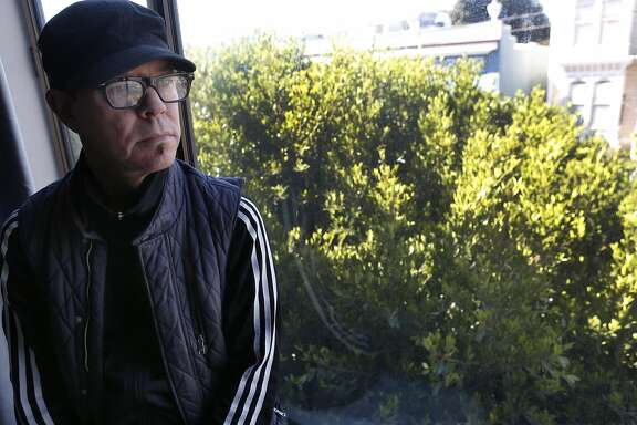 Randy Gzebb is seen with a ficus tree growing in front of his Fillmore Street home in San Francisco, Calif. on Saturday, Sept. 17, 2016. Gzebb and his neighbors have been forced to pay repair costs for sidewalk damage caused by the tree's root system. But responsibility for sidewalk repair and tree maintenance would become the city's if Prop. E passes in Novemenber.