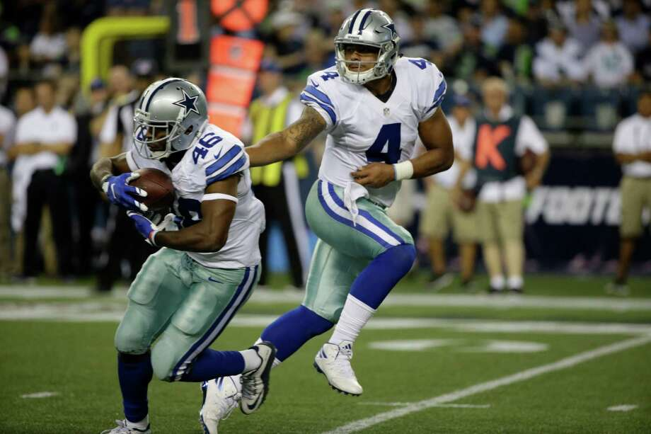 Dallas Cowboys quarterback Dak Prescott hands off to running back Alfred Morris  in the first half of a preseason NFL football game, Thursday, Aug. 25, 2016, in Seattle. (AP Photo/Elaine Thompson) Photo: Elaine Thompson, STF / Associated Press / AP