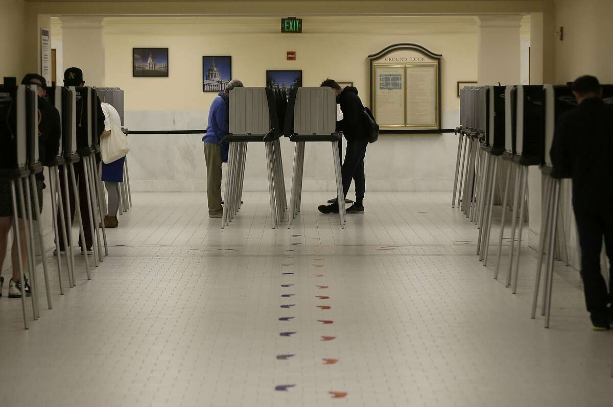 Voters cast ballots in voting booths at City Hall in San Francisco, Tuesday, June 7, 2016. Voter turnout is expected to be higher then normal in the nation's most populous state for Tuesday's presidential primary. (AP Photo/Jeff Chiu)
