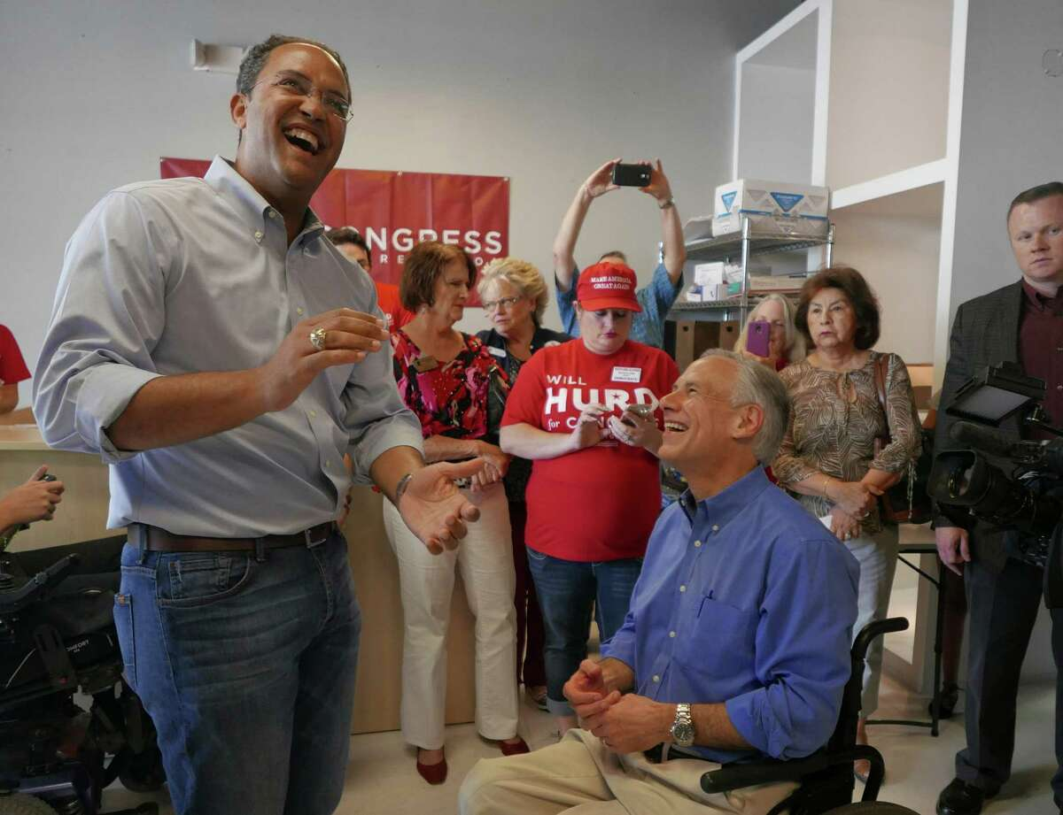 U.S. Rep. Will Hurd of San Antonio, left, enjoys a light-hearted moment with Texas Gov. Greg Abbott at Hurd's campaign headquarters near Loop 1604 at Huebner on Saturday, Sept. 17, 2016. Abbott pledged his support of Hurd in his 23rd Congressional District race against Democrat Pete Gallego.