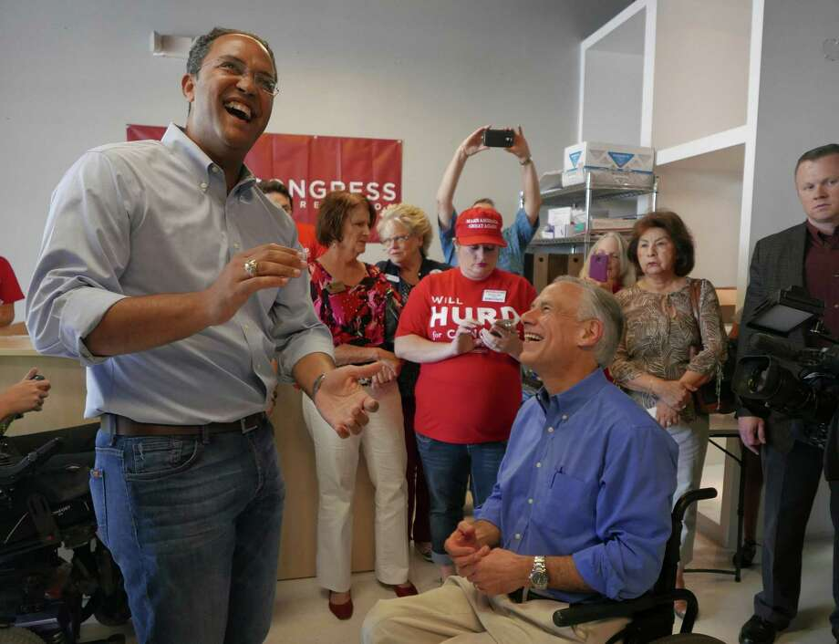 U.S. Rep. Will Hurd of San Antonio, left, enjoys a light-hearted moment with Texas Gov. Greg Abbott at Hurd's campaign headquarters near Loop 1604 at Huebner on Saturday, Sept. 17, 2016. Abbott pledged his support of Hurd in his 23rd Congressional District race against Democrat Pete Gallego. Photo: Billy Calzada, Staff / San Antonio Express-News / San Antonio Express-News