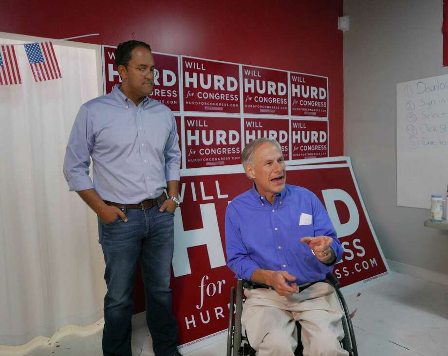 Texas Gov. Greg Abbott speaks on behalf of U.S. Rep. Will Hurd, left, at Hurd's campaign headquarters near Loop 1604 at Huebner on SaturdayIncumbent Hurd is battling against former Congressman Pete Gallego in one of the most closely watched U.S. House races in the nation. Photo: Billy Calzada /San Antonio Express-News / San Antonio Express-News