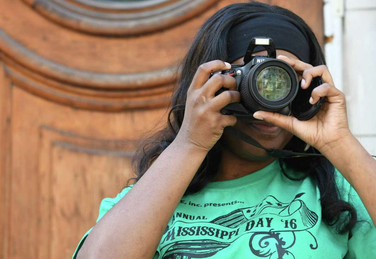Brittney White takes photographs of the kickoff of the 5th annual event commemorating Albany's history of African American migration from the South for opportunity and a better life Mississippi Day on Saturday Sept. 17, 2016 in Albany, N.Y. (Michael P. Farrell/Times Union)