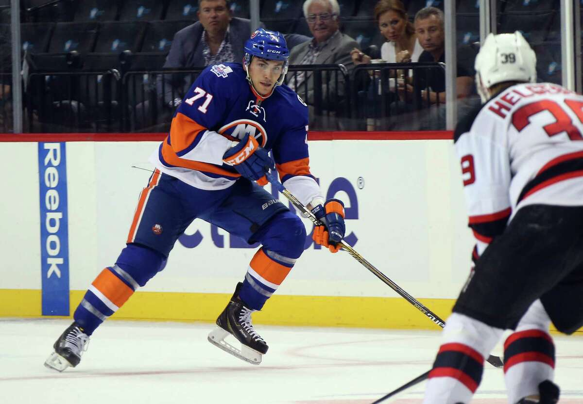 NEW YORK, NY - SEPTEMBER 23: Michael Dal Colle #71 of the New York Islanders skates against the New Jersey Devils at the Barclays Center on September 23, 2015 in the Brooklyn borough of New York City. The Islanders defeated the Devils 2-1. (Photo by Bruce Bennett/Getty Images)
