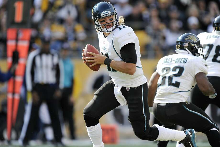 Jacksonville Jaguars quarterback Blaine Gabbert (11) rolls out to pass against the Pittsburgh Steelers during the fourth quarter of a football game Sunday, Oct. 16, 2011 in Pittsburgh. Pittsburgh won 17-13.(AP Photo/Don Wright) Photo: DON WRIGHT, Associated Press
