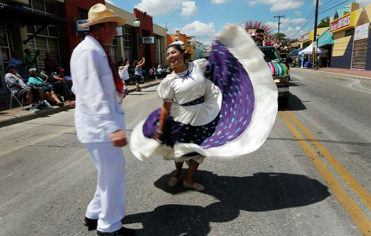 Ballet Folklorico de San Antonio dancers perform as they take part in the Avenida Guadalupe neighborhood Diez y Seis de Septiembre Parade on Saturday, Sept. 17, 2016. Hundreds of parade watchers lined the streets on the city's Westside as about 60 floats, marchers and bands cruised through to celebrate Mexico's independence from Spain. Food, music and presentations followed throughout the day at Plaza de Guadalupe. (Kin Man Hui/San Antonio Express-News)