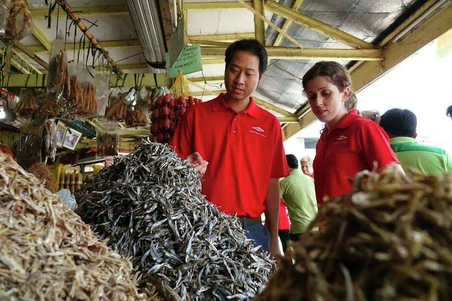 In this provided photo, Dow Leadership in Action participants conduct market research to help support and foster the production and commercialization of dried food products that are acceptable to local and export markets in the Philippines.