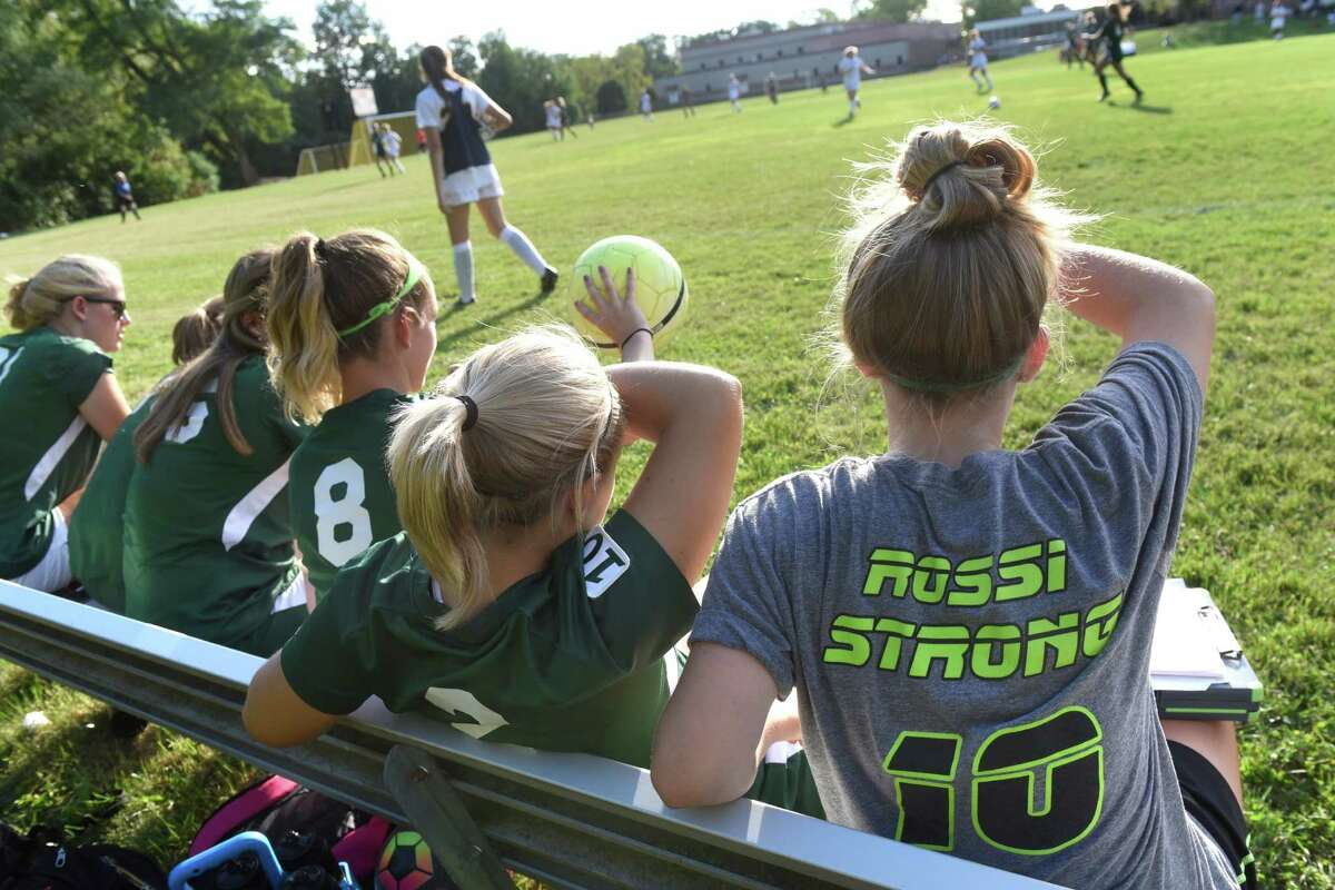 Schalmont's Molly Older, 16, right, wears a T-shirt to support her teammate Davia Rossi during their soccer game on Friday, Sept. 9, 2016, at Albany Academy for Girls in Albany, N.Y. The players also wore the number 10 on a shoulder patch. Rossi is a freshman soccer player who is missing this season while she undergoes treatment for cancer. (Cindy Schultz / Times Union)