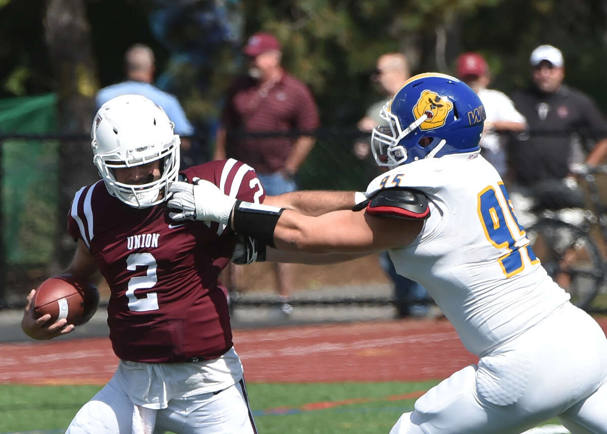 Union quarterback Nick Cascione runs for some yardage against Western New England in a 32-16 loss to the Golden Bears on Saturday, Sept. 18, 2016, at Frank Bailey Field in Schenectady. (Trent Hermann / Carlyn Studios)