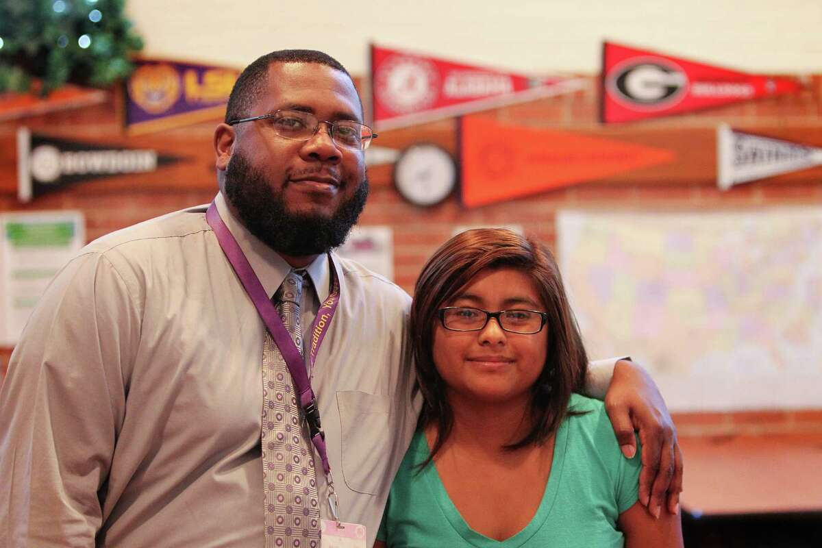 With the help of College Success Advisor Aaron Bishop, left, recent Northside High graduate Ana Hernandez will be the first person in her family to attend college.